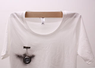 Coal dust smudge on organic cotton t-shirt