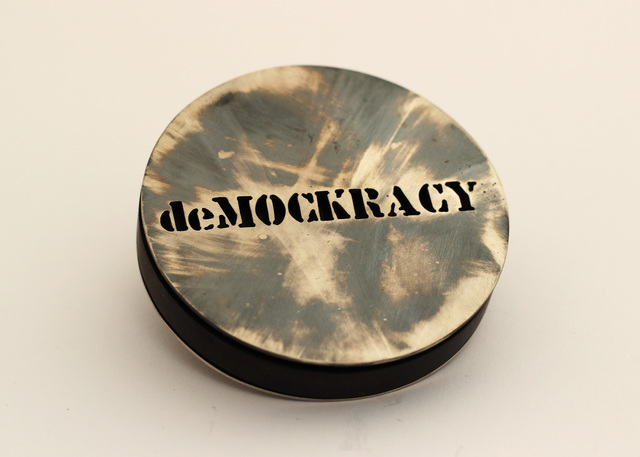 deMOCKRACY brooch